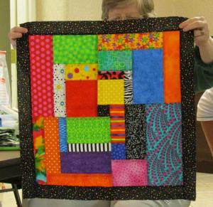 Cathy's wild log cabin mini-quilt for her guild's show challenge.
