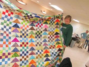 Cathy's amazing batik quilt with lots and lots of flying geese.
