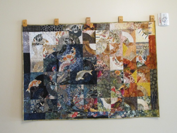 Beautiful quilt displayed in lobby.