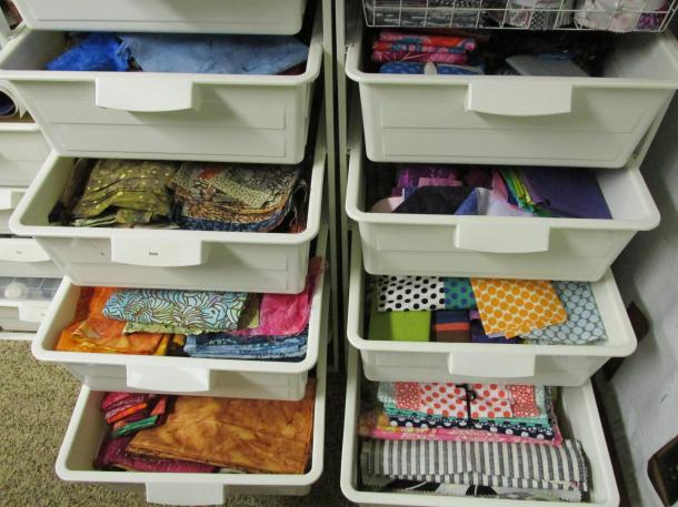 Bins - 8 of 12 filled with fat quarters and other cuts.