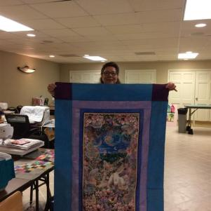 One of two sweet panel quilt tops